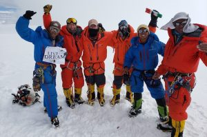A team celebrating on the summit of Cho Oyu