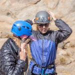 Climbers putting helmets on before rock climbing on Donner Summit