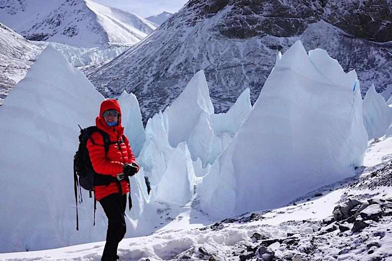 Standing in front of ice pillars on Mt Everest