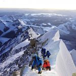 A team of climbers on a crisp morning near the summit of Mt Everest