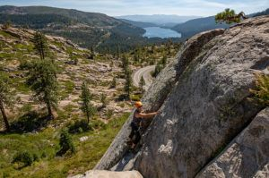 Female rock climber scaling a cliff on Donner Summit