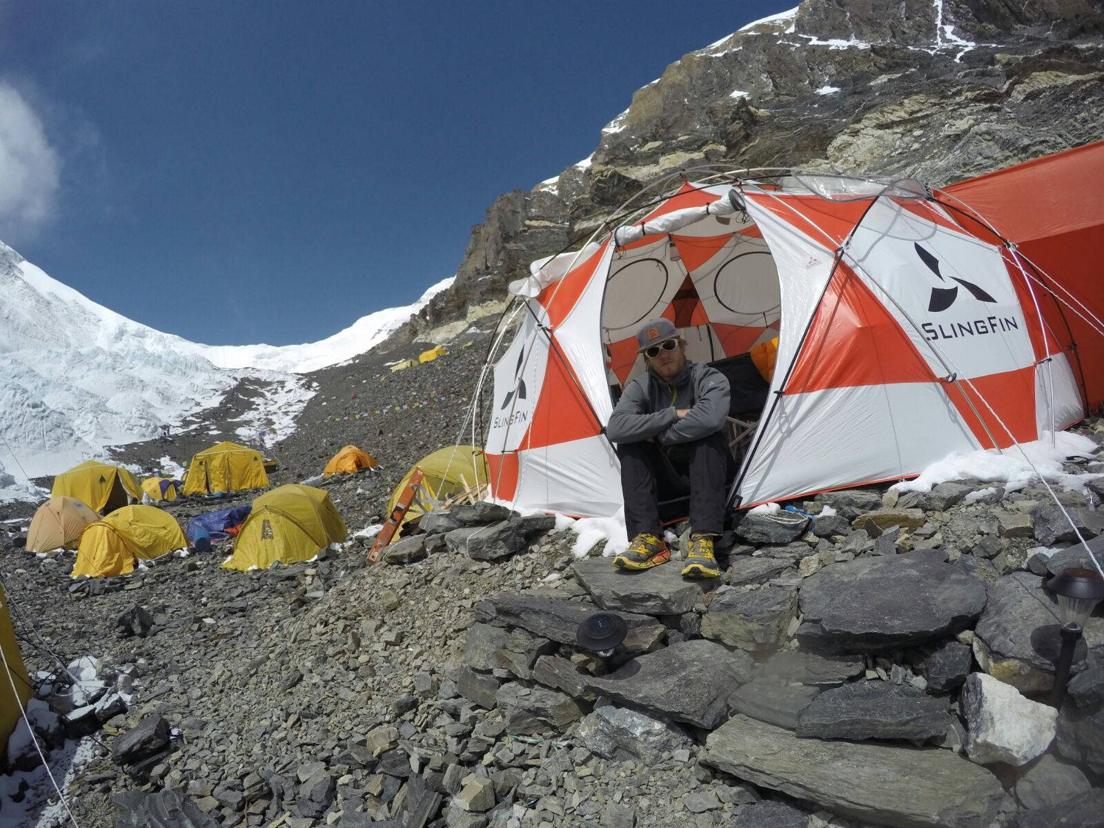 Cory Richards sitting in Advanced Base Camp on the North Side of Mt Everest in 2016