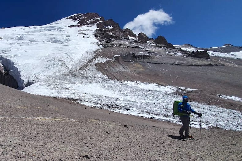 A climber walking below the polish glacier on Aconcagua